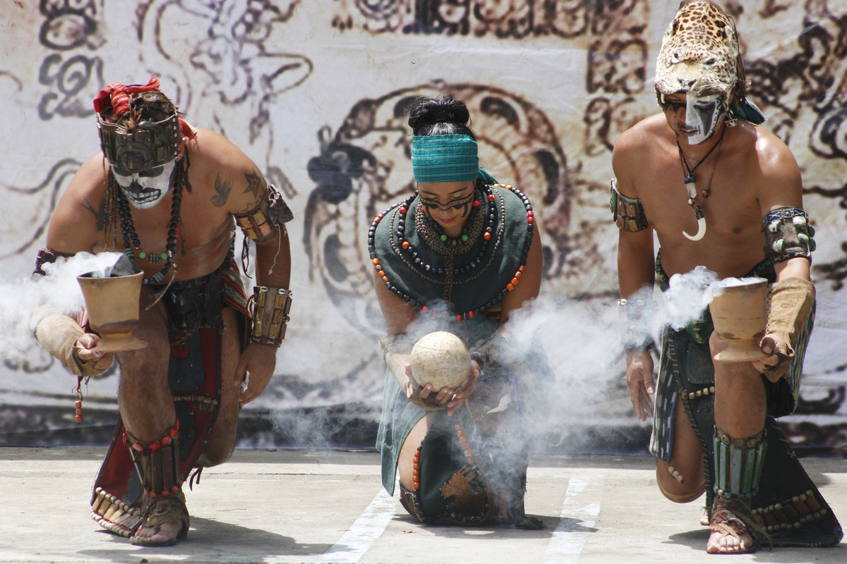 Members of the Maya people of Guatemala perform a ceremonial ritual in honor of the sun