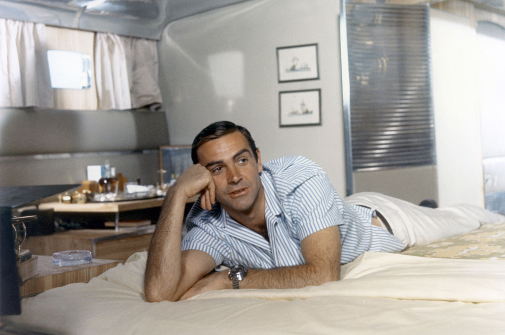 Connery laying on a bed