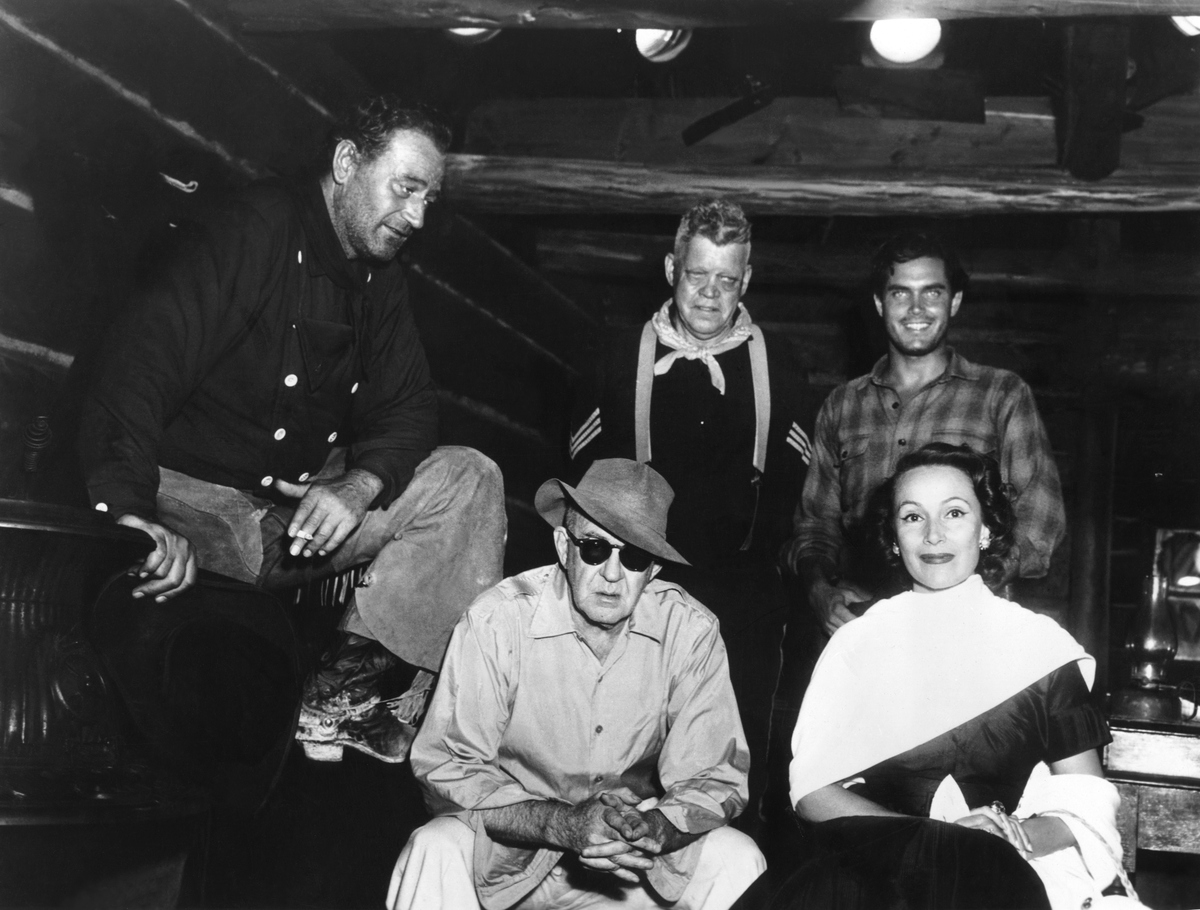 American actors John Wayne, Jack Pennick, Jeffrey Hunter and Mexican actress Dolores Del Rio with director John Ford on the set of his movie The Searchers.