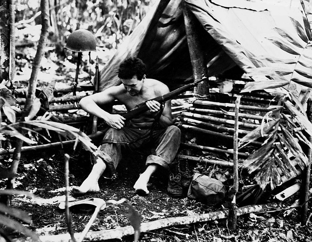Marine  in tropical dwelling, Guadalcanal, Solomon Island