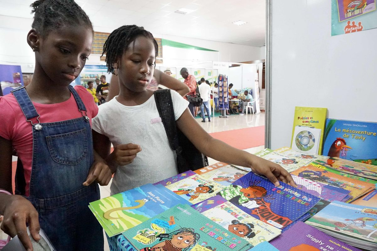 Children look at books during the newspaper cartoon and comic books festival Coco Bulles