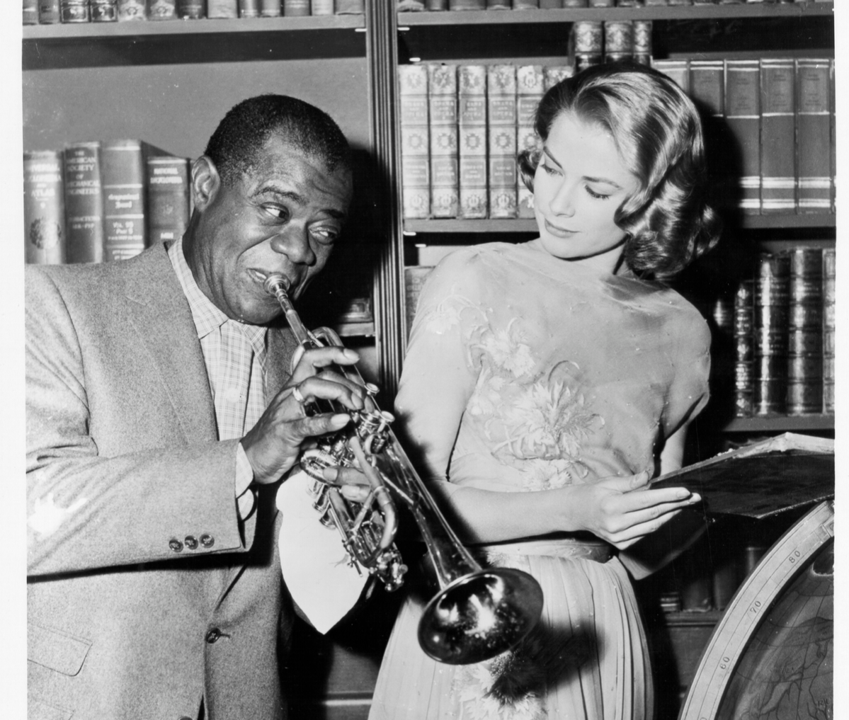 Louis Armstrong and Grace Kelly on the set of 'High Society'.