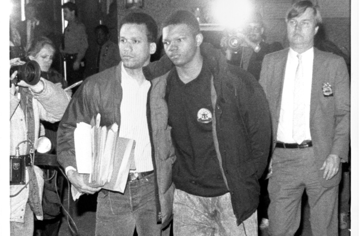 Police escort 14-year old Kevin Richardson into the 24th Precinct. April 19, 1989.