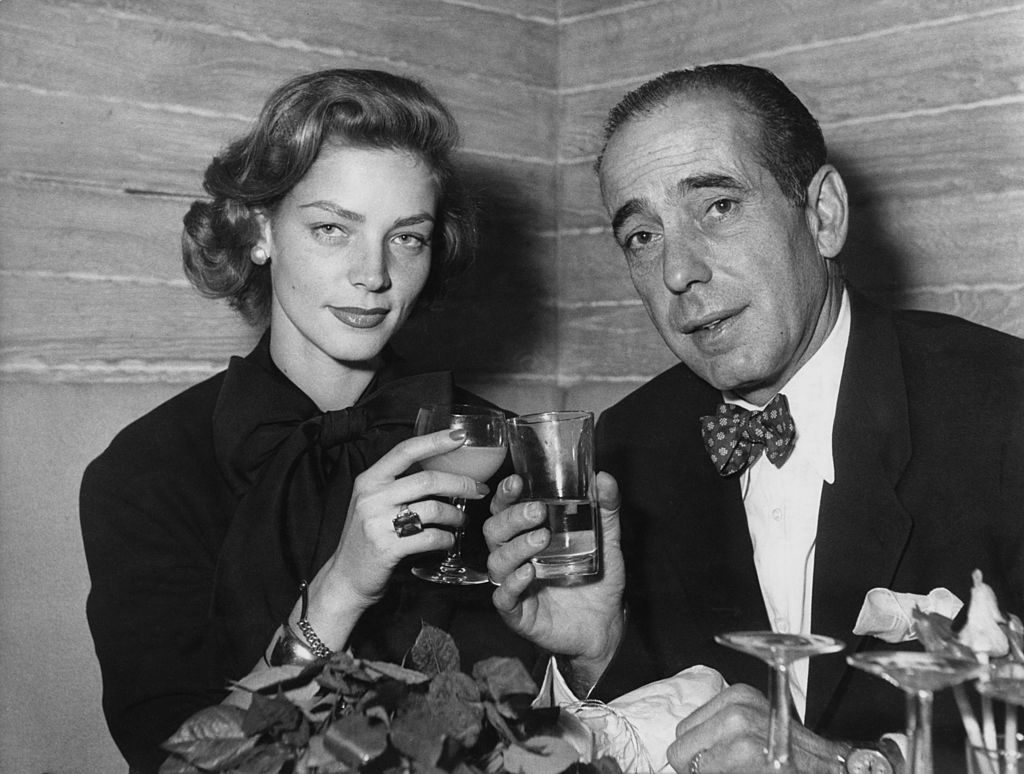 Bogart and Bacall raise a glass in toast