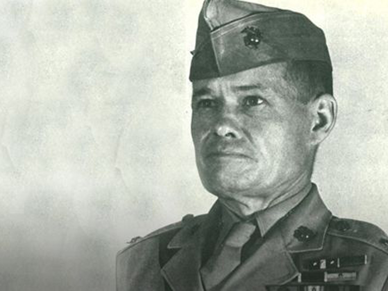 Chesty Puller in full uniform looking tough as nails
