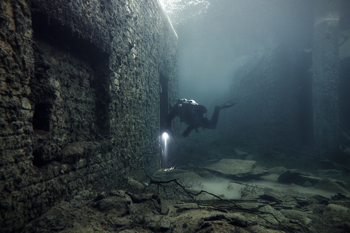 diver in a secret cave
