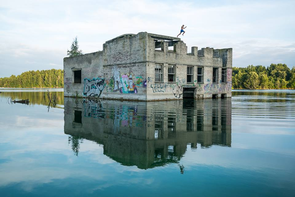 building in the water with graffiti