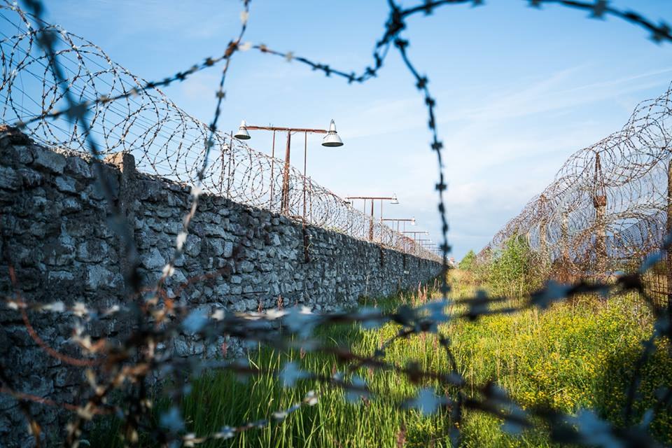 barbed wire around green valley