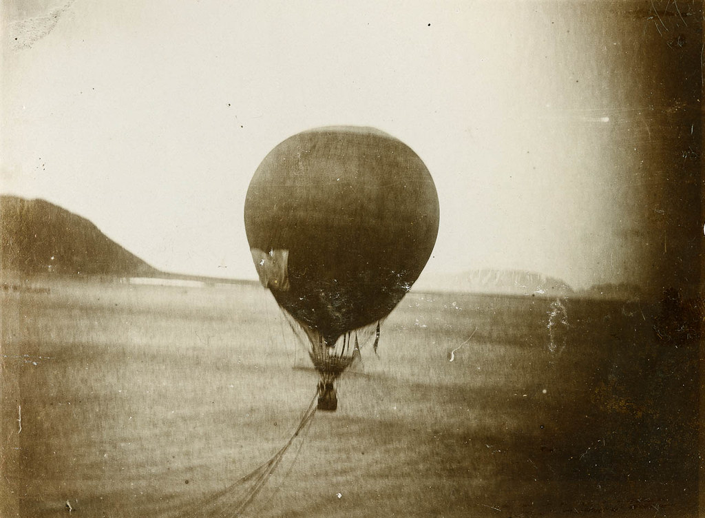 vintage photo of hot air balloon with patch on the side of it