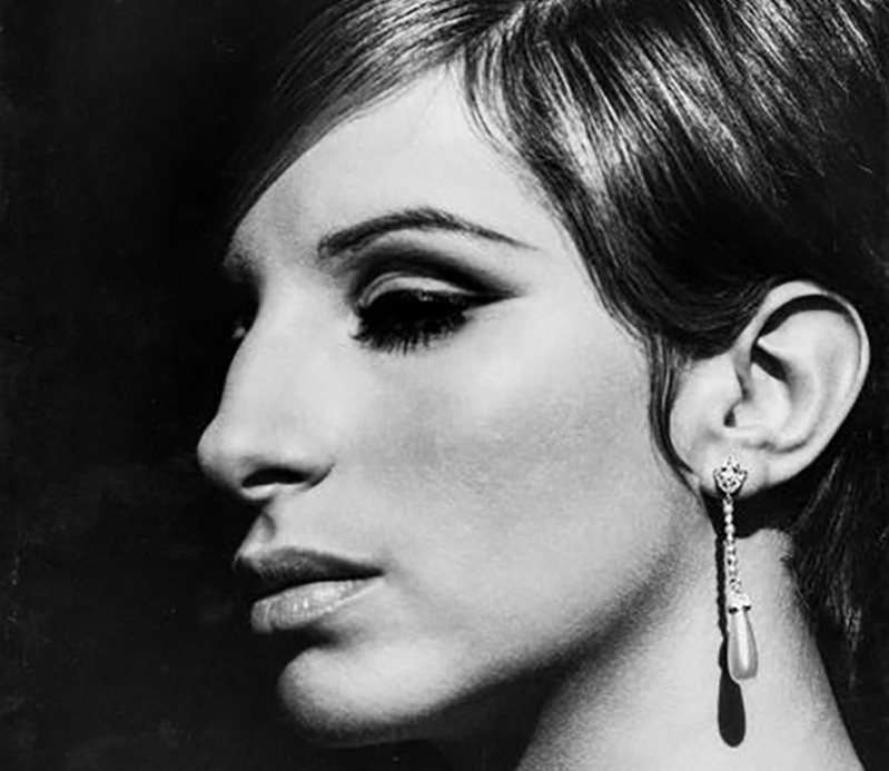 Barbra Streisand in diamond linear earrings