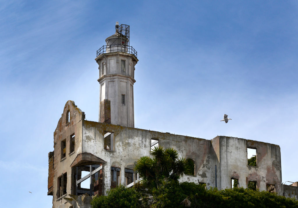 The ruins of the Warden's House stand beside Alcatraz Island Lighthouse at the former Alcatraz Federal Penitentiary on Alcatraz Island in San Francisco Bay.