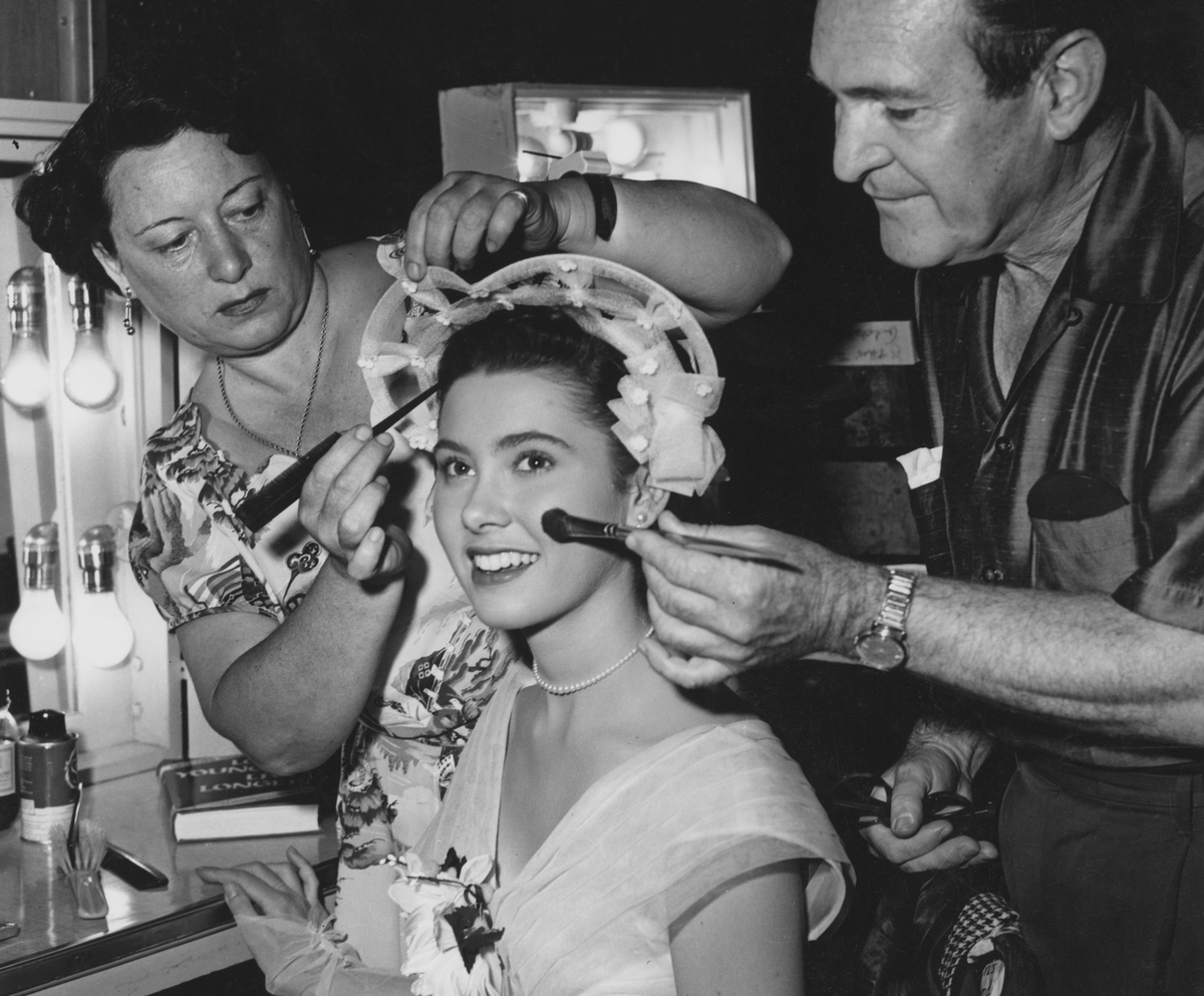 American actress Elinor Donahue receives the attention of hair stylist Hazel Keats and make-up artist Ray Sebastian