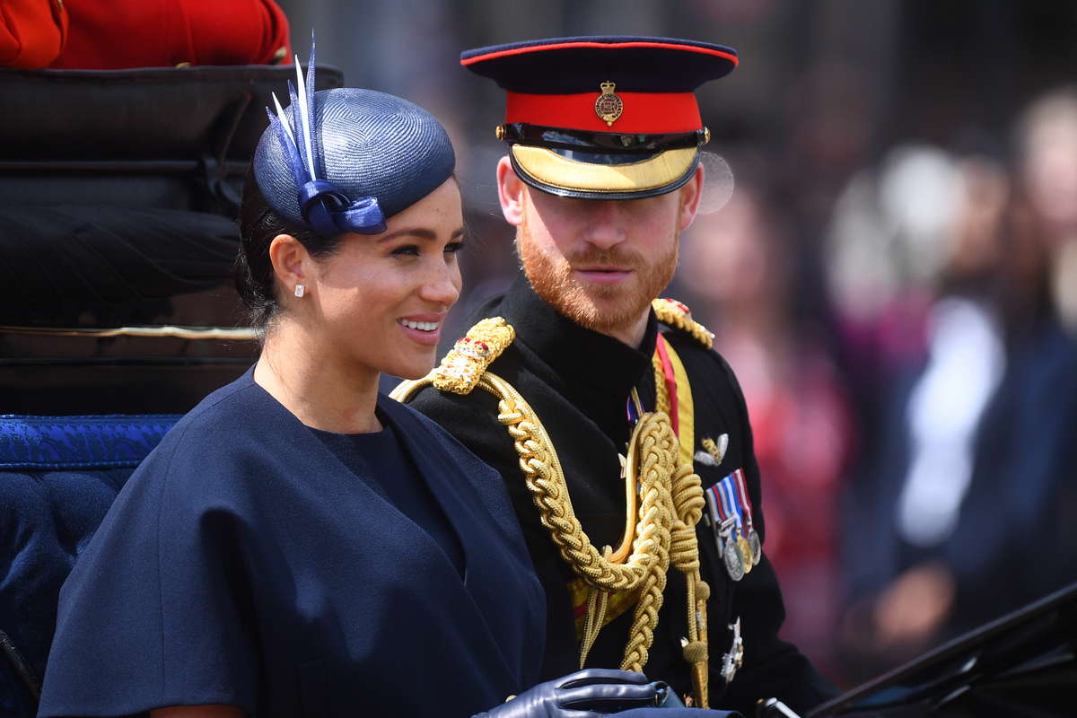 The Duke and Duchess of Sussex make their way along The Mall to Buckingham Palace, in London, after the Trooping the Colour ceremony, as Queen Elizabeth II celebrates her official birthday.