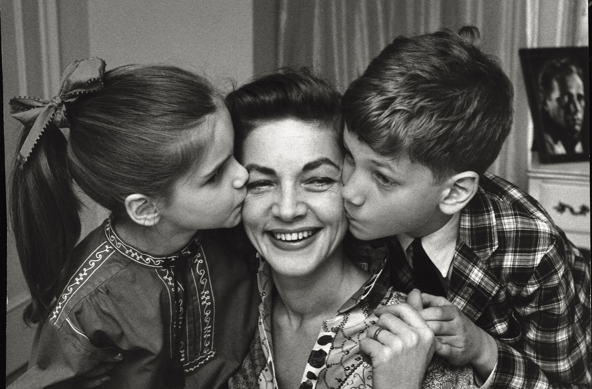 The American actress Lauren Bacall fondly plays with her children Leslie and Stephen