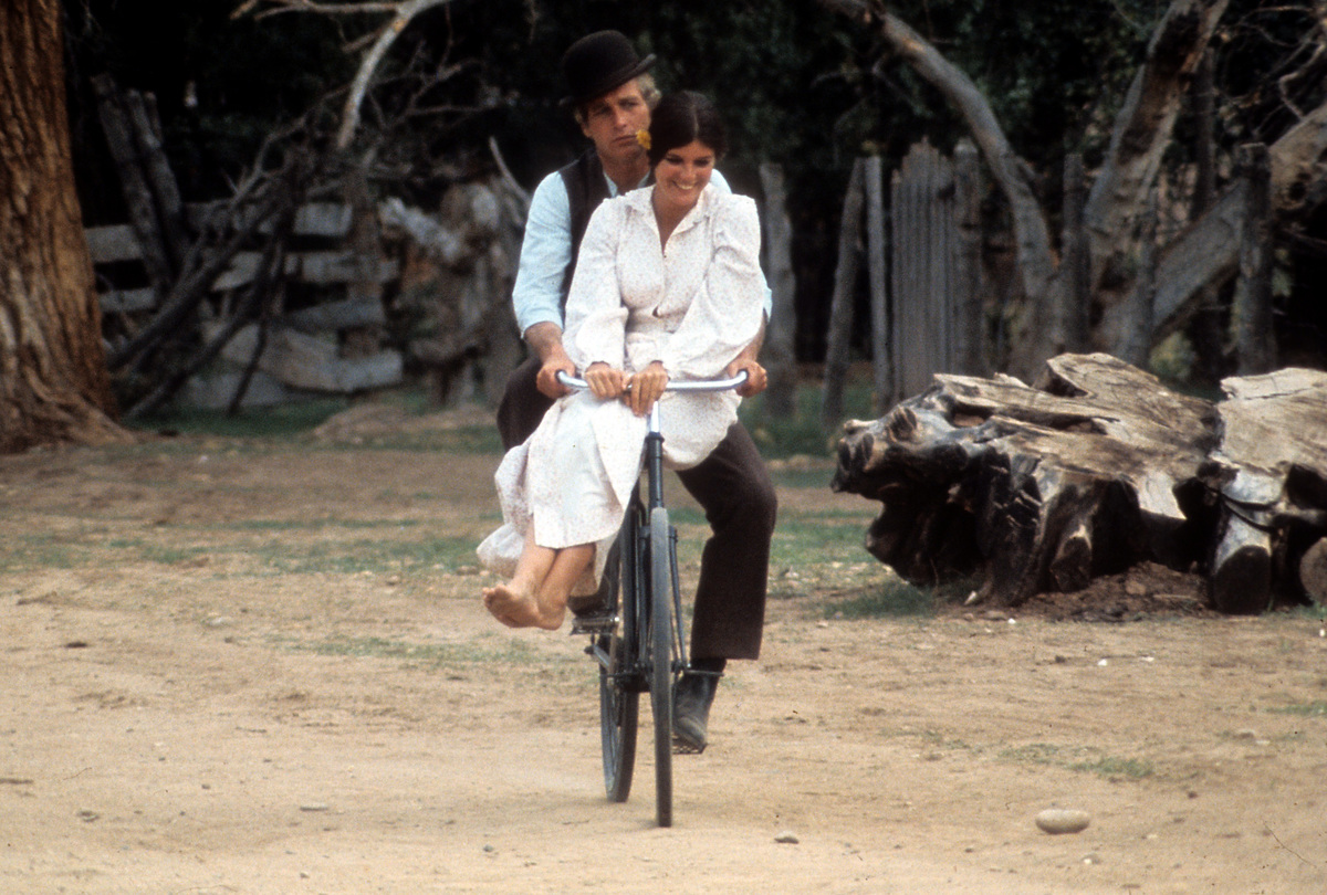 Paul Newman and Katharine Ross double riding on a bicycle in a scene from the film 'Butch Cassidy and the Sundance Kid', 1969.