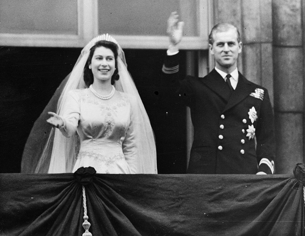 GettyImages-3333252 Princess Elizabeth and The Prince Philip, Duke of Edinburgh waving to a crowd from the balcony of Buckingham Palace