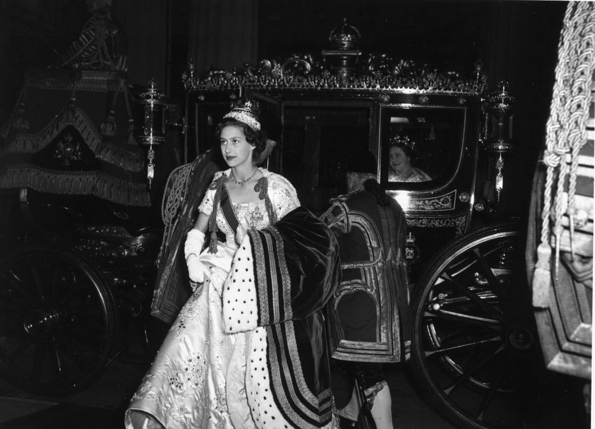 Princess Margaret Rose (1930 - 2002) getting out of a state coach after attending the coronation of her sister, Queen Elizabeth II.