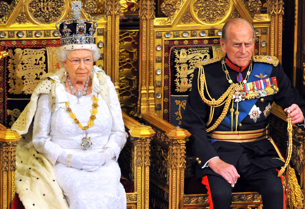 GettyImages-495538417 Queen Elizabeth II sits with Prince Philip, Duke of Edinburgh as she delivers her speech during the State Opening of Parliament