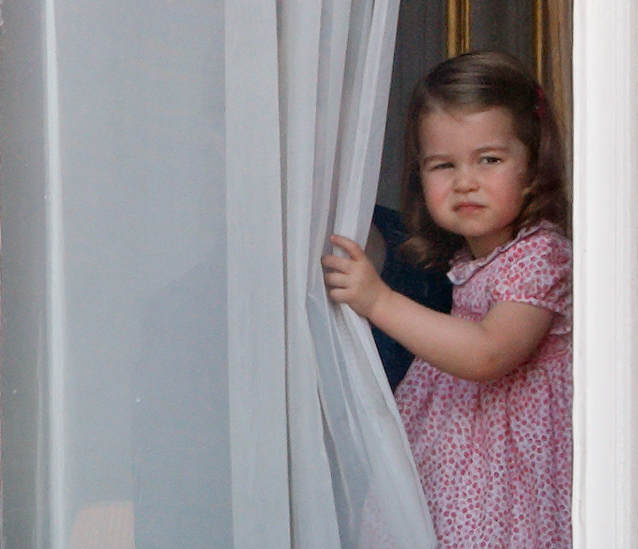 Princess Charlotte of Cambridge watches from a window of Buckingham Palace during the annual Trooping the Colour Parade on June 17, 2017 in London, England.