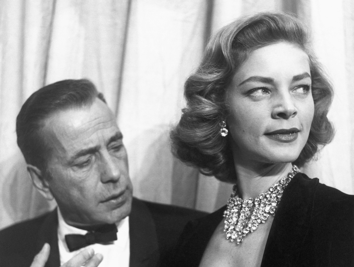 Actors Humphrey Bogart and Lauren Bacall attend the Academy Awards in 1955