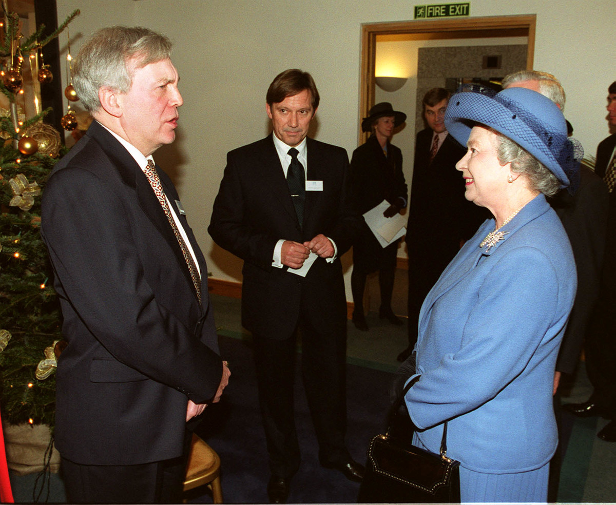 The Queen chats with Royal journalist Roger Williams and Court Correspondent Peter Archer (centre) during a visit to the PA News Centre in Victoria.