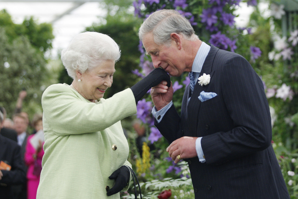 Queen Elizabeth II presents Prince Charles, Prince of Wales with the Royal Horticultural Society's Victoria Medal of Honour during a visit to the Chelsea Flower Show on May 18, 2009 in London.