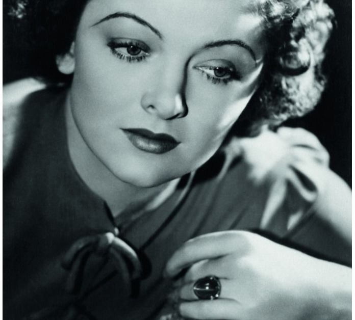 Myrna Loy in a promotional from The Thin Man wearing a sapphire ring