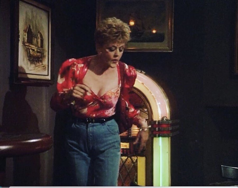 lansburry wearing a blouse