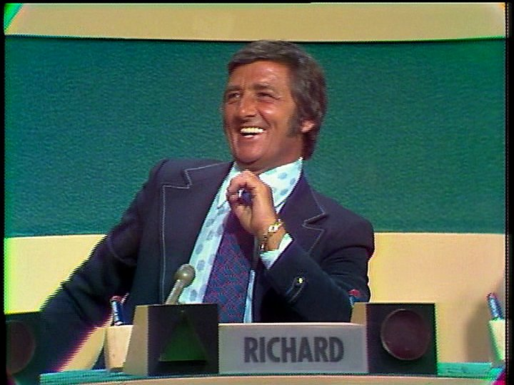 a still of richard dawson