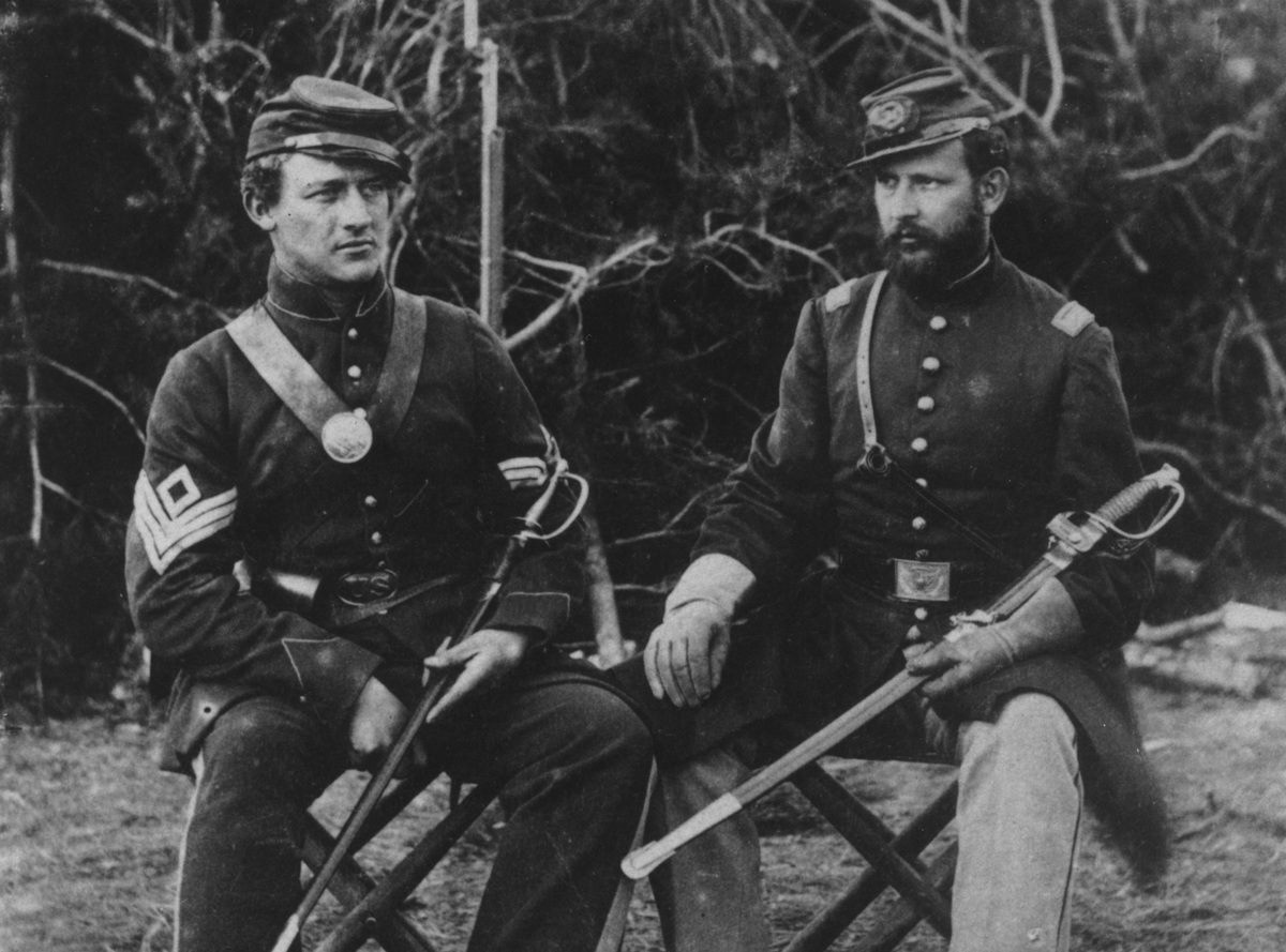 Two Union soldiers of the 31st Pennsylvania Regiment seated with swords during the US civil war, circa 1861.