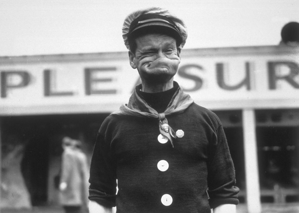 photograph of someone making a face like popeye