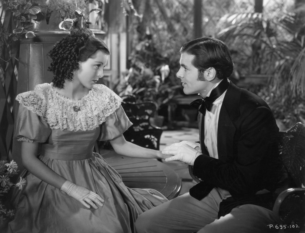 A still-phrame reveals Frances Dee portraying Meg in the 1933 film version of Little Women