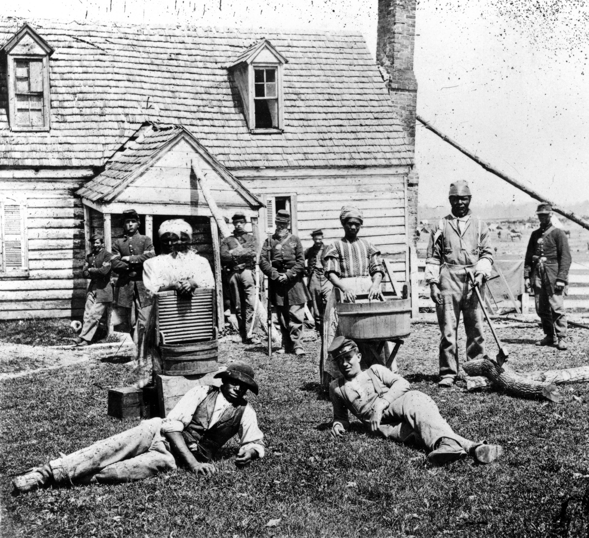 Group of contraband slaves at Allens farm house near Williamsburg Road, in the vicinity of Yorkville, Virginia, during the American Civil War, from the New York Public Library, 1862.