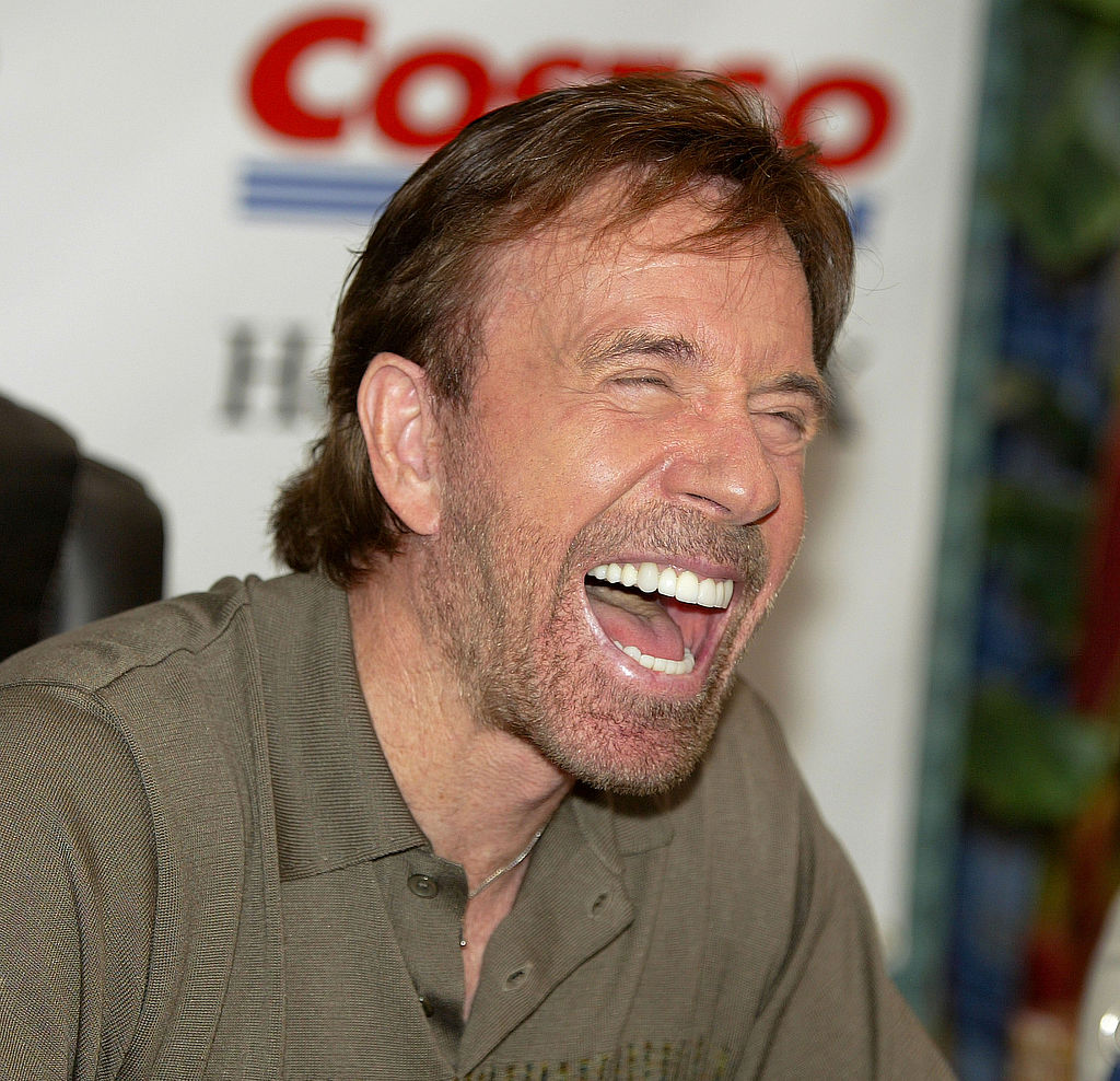 chuck norris laughing at a joke
