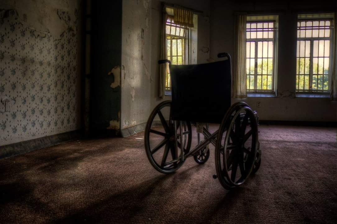 empty wheelchair in the abandoned Trans Allegheny Lunatic Asylum