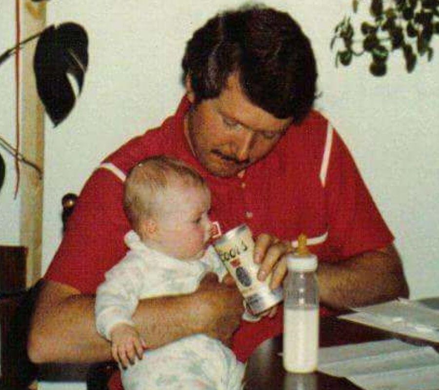 dad feeding baby beer