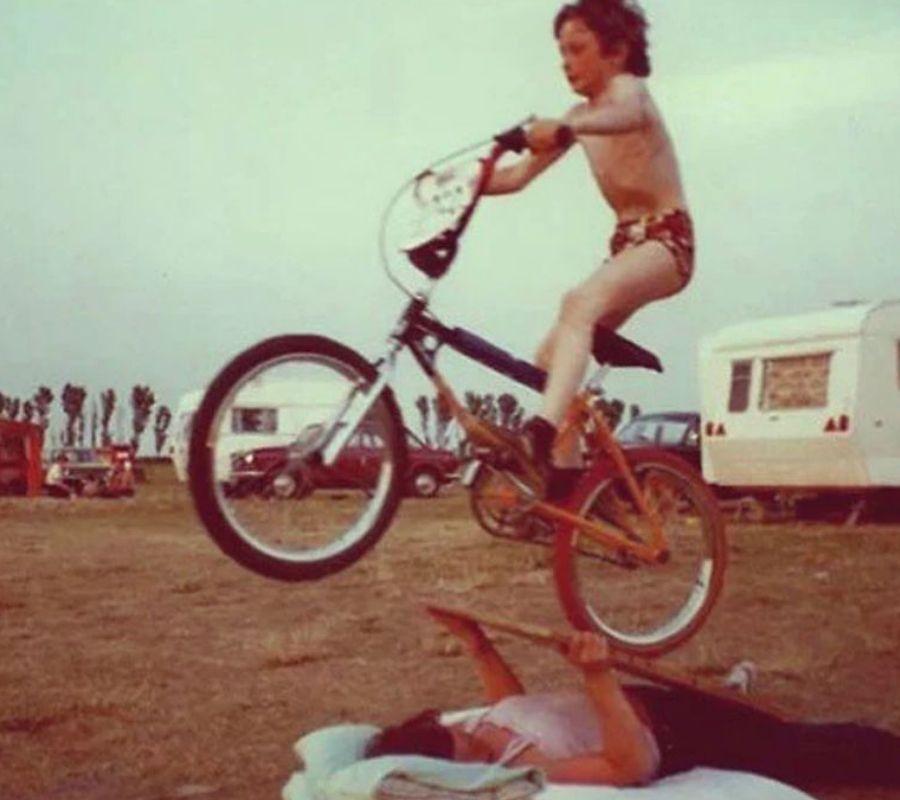 kid biking over mother