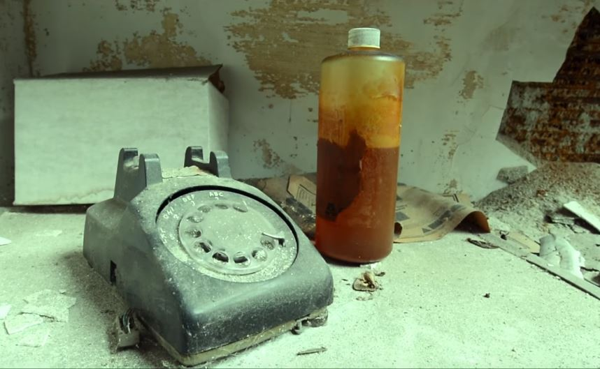 old telephone and paint in the abandoned Fernald State School, Massachusetts