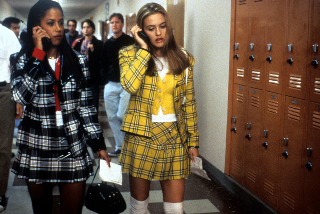 Stacey Dash and Alicia Silverstone walking and talking on their mobile phones in a scene from the film 'Clueless'