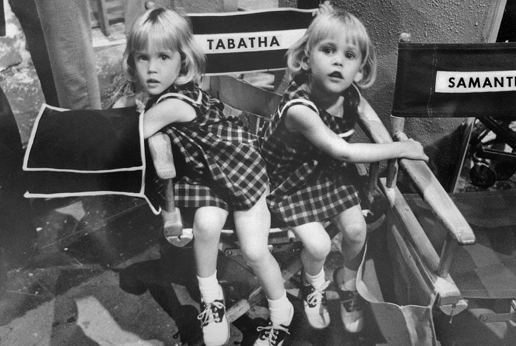 erin and diane murphy sitting in a director's chair on the set of bewitched