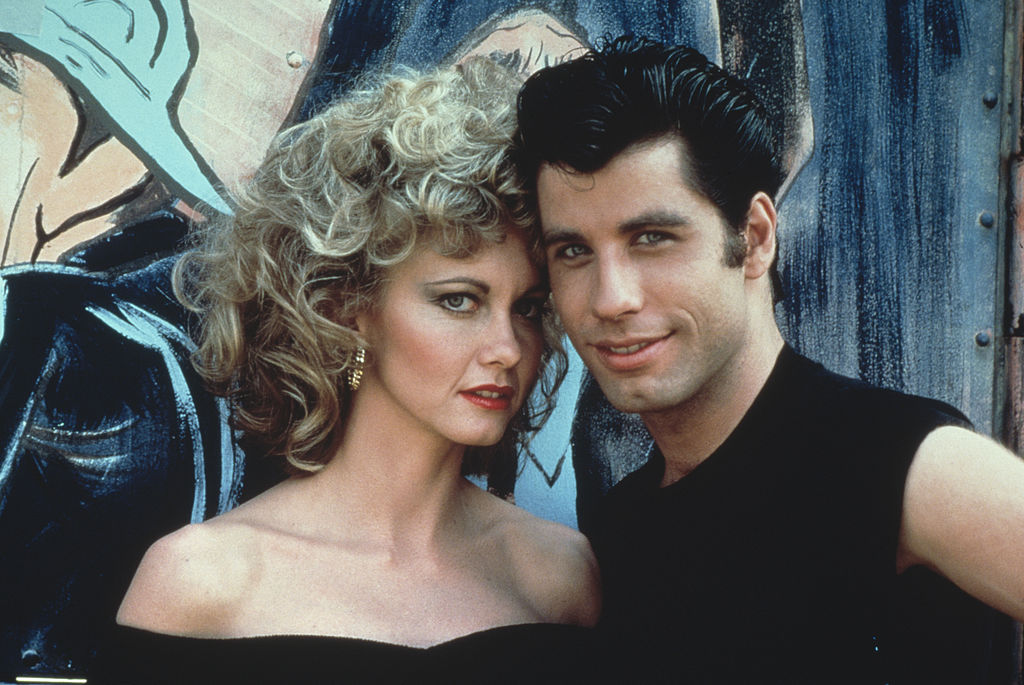 olivia newton-john and john travolta in costume for grease