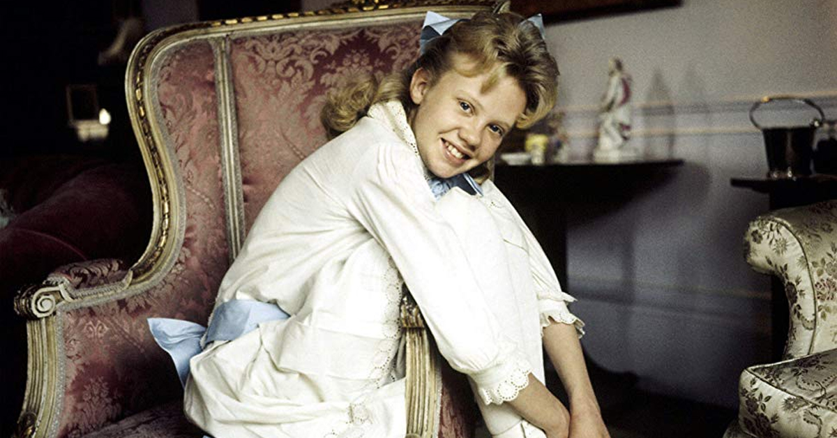 hayley mills as a kid sitting in a chair