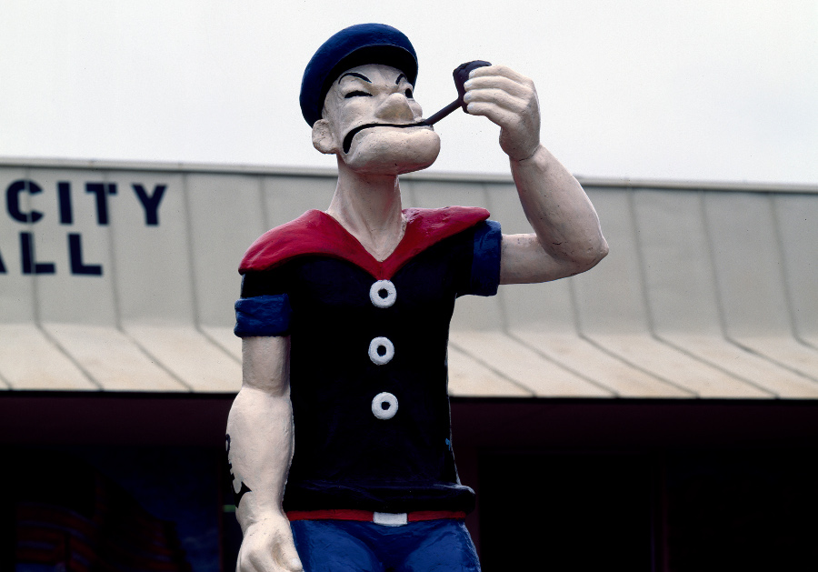 a statue of popeye smoking a pipe