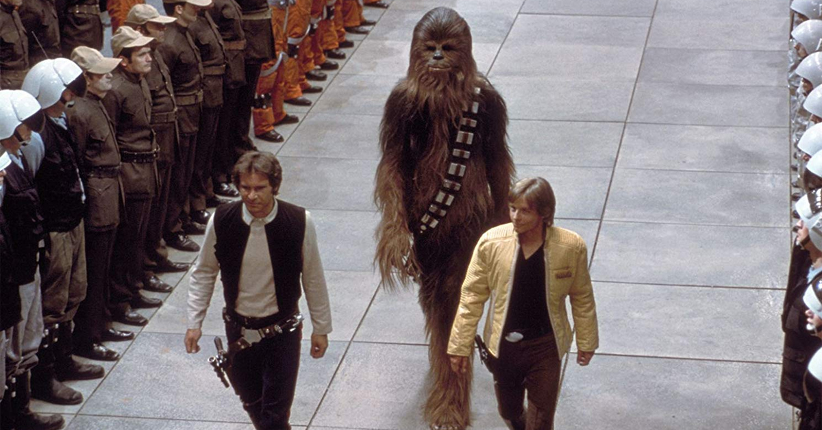 harrison ford, mark hamill, and peter mayhew in costume on set of star wars