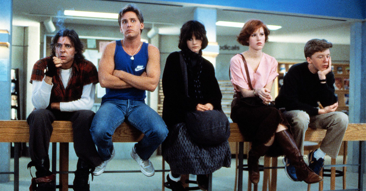 the cast of the the breakfast club sitting on a ledge in the library
