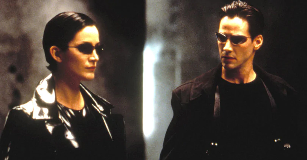 carrie-anne moss and keanu reeves wearing all black in the matrix