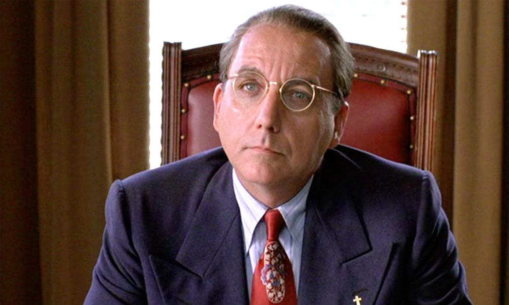 Warden Norton at desk