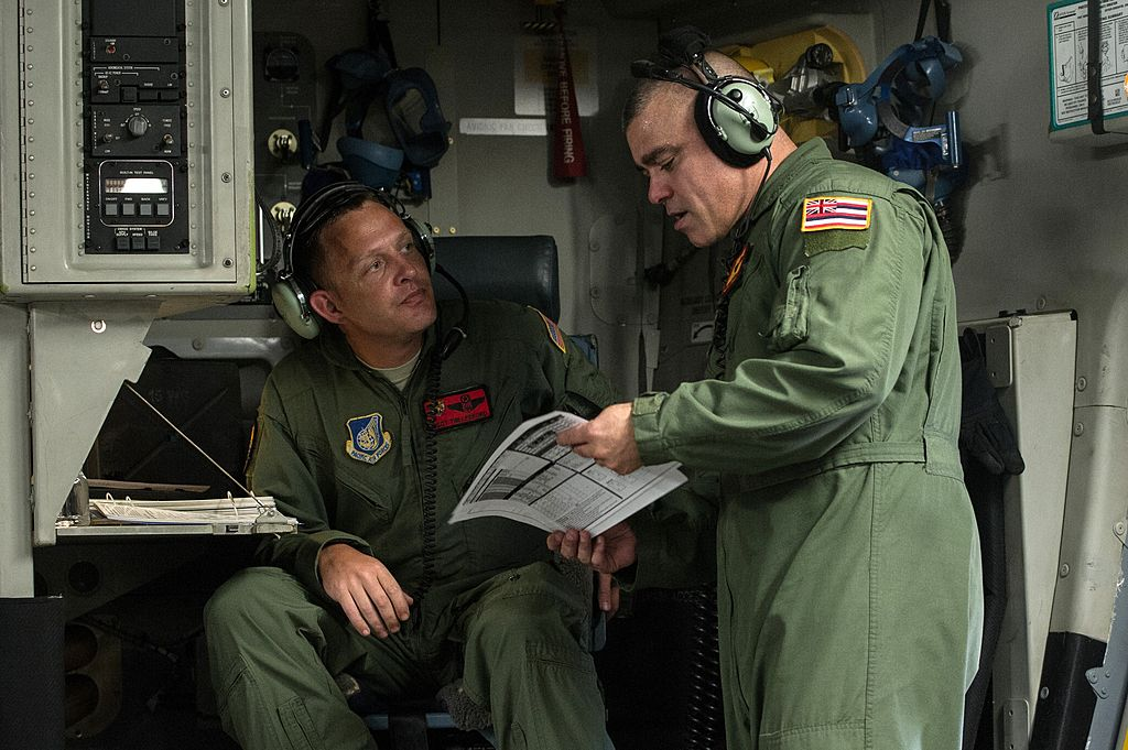Two airmen talking