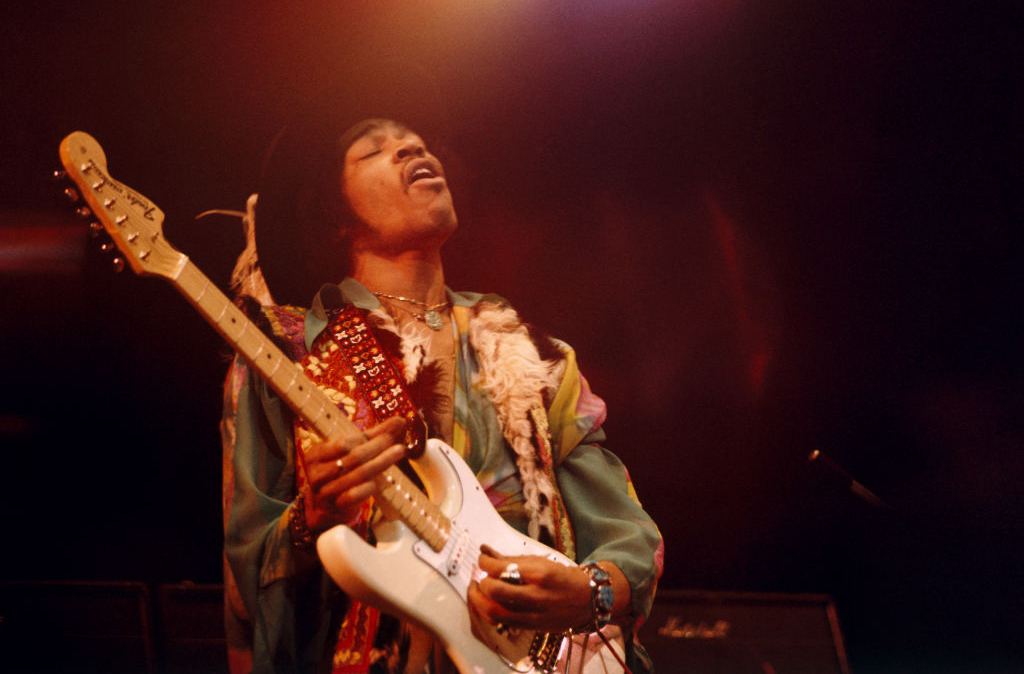 Jimi Hendrix playing on stage