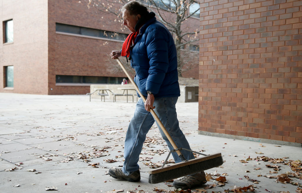Sweeping leaves outside